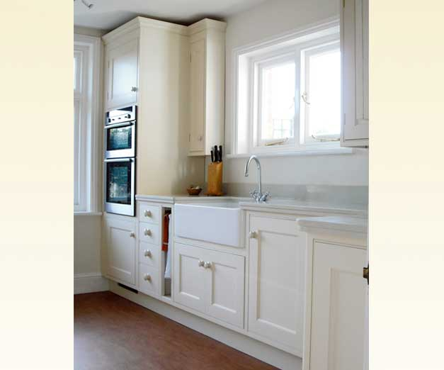 kitchen sink and cupboards painted white